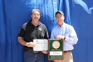 On behalf of the Town of Florence, John Nixon accepts Certificate of Recognition from the State of Arizona Department of Forestry